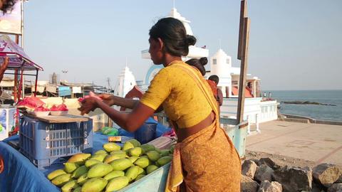 KANYAKUMARI, INDIA - MARCH 2013: Women selling fru Stock Video Footage