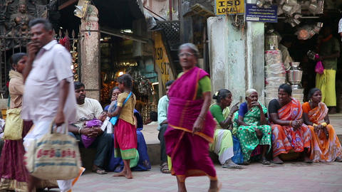 MADURAI, INDIA - MARCH 2013: Girl selling newspape Stock Video Footage