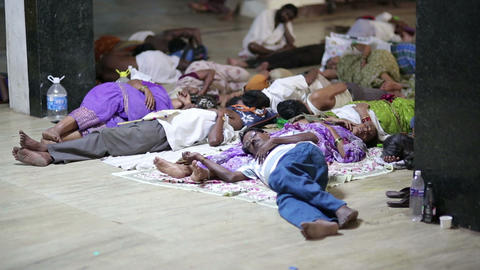 MADURAI, INDIA - MARCH 2013: People sleeping in th Stock Video Footage