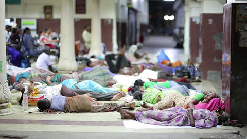 MADURAI, INDIA - MARCH 2013: People sleeping on ra Footage