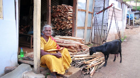 OOTY, INDIA - MARCH 2013: Old woman trading firewo Stock Video Footage