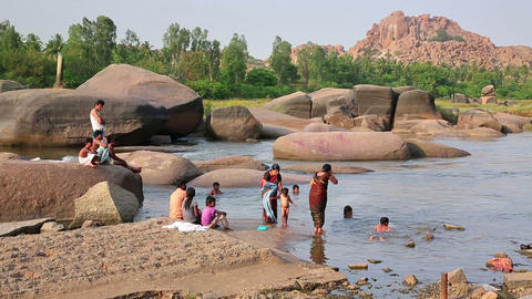 HAMPI, INDIA - APRIL 2013: People bathing in mount Stock Video Footage