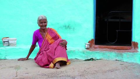 HAMPI, INDIA - APRIL 2013: Old woman in sari Stock Video Footage