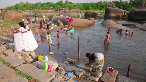 HAMPI, INDIA - APRIL 2013: Local women doing laund Footage