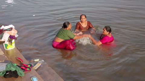 HAMPI, INDIA - APRIL 2013: Local women splashing i Stock Video Footage