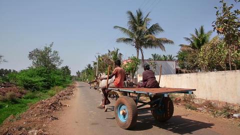 HAMPI, INDIA - APRIL 2013: Everyday village scene Stock Video Footage