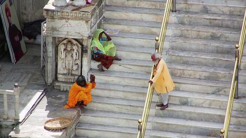 UDAIPUR, INDIA - APRIL, 2013: People sitting on st Stock Video Footage
