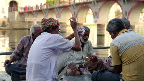 UDAIPUR, INDIA - APRIL, 2013: People playing cards Stock Video Footage