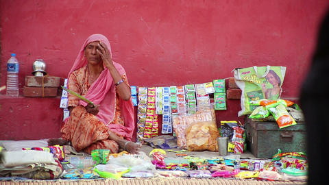 JAIPUR, INDIA - APRIL, 2013: Woman selling goods i Stock Video Footage