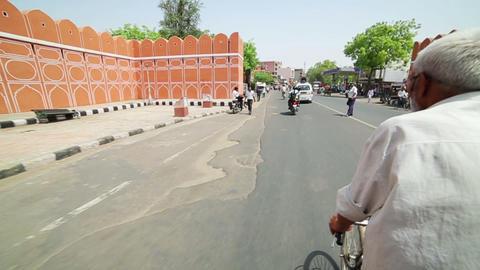 JAIPUR, INDIA - APRIL, 2013: Man riding rickshaw i Stock Video Footage