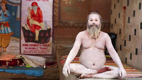 VARANASI, INDIA - MAY 2013: Naked Sadhu posing Stock Video Footage