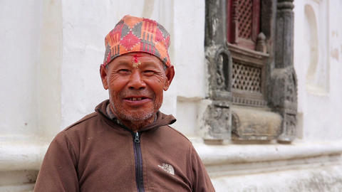 KATHMANDU, NEPAL - JUNE 2013: nepalese man with tr Stock Video Footage