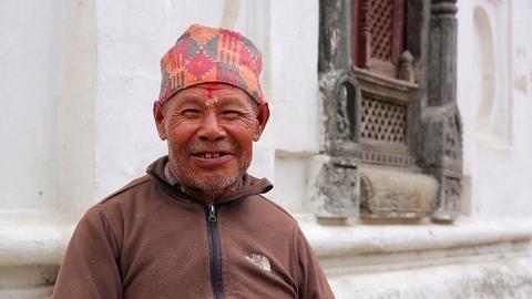 KATHMANDU, NEPAL - JUNE 2013: nepalese man with tr Footage