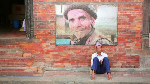 KATHMANDU, NEPAL - JUNE 2013: nepalese man with tr Footage