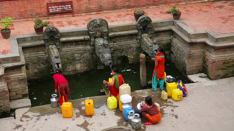 KATHMANDU, NEPAL - JUNE 2013: people pouring water Stock Video Footage