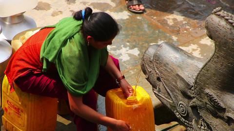 KATHMANDU, NEPAL - JUNE 2013: people pouring water Stock Video Footage