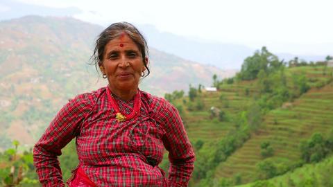 NAGARKOT, NEPAL - JUNE 2013: Nepali vilager at her Stock Video Footage