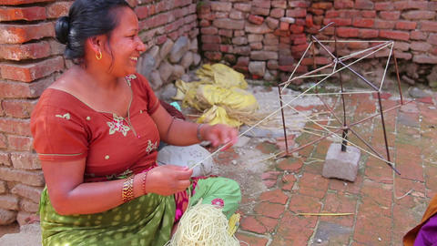 KATHMANDU, NEPAL - JUNE 2013: local woman knitting Stock Video Footage