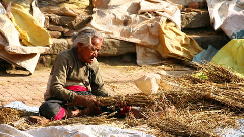 KATHMANDU, NEPAL - JUNE 2013: old woman worker at Stock Video Footage