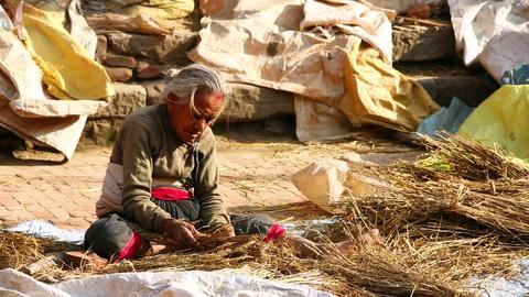KATHMANDU, NEPAL - JUNE 2013: Old Woman Worker At  stock footage