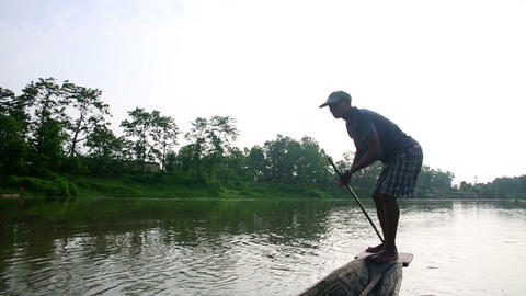 CHITWAN, NEPAL - JUNE 2013: traditional boat and b Stock Video Footage