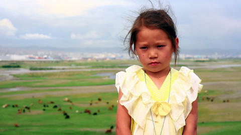 ULAANBAATAR, MONGOLIA - JULY 2013: Mongol kid posi Footage
