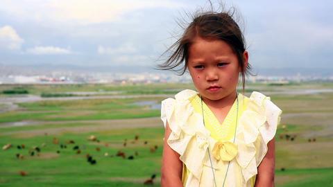 ULAANBAATAR, MONGOLIA - JULY 2013: Mongol kid posi Stock Video Footage