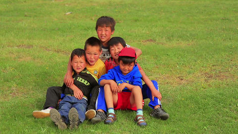 ULAANBAATAR, MONGOLIA - JULY 2013: Mongol kids pos Stock Video Footage