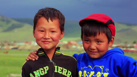 ULAANBAATAR, MONGOLIA - JULY 2013: Mongol kids pos Footage