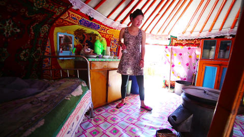 MONGOLIA - JULY 2013: Mongolian family inside yurt Footage