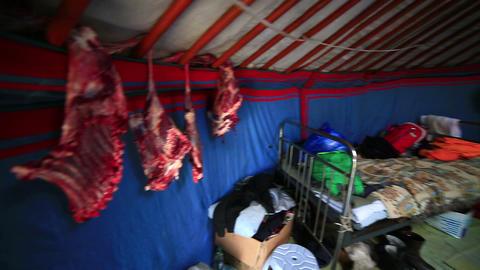 MONGOLIA - JUNE 2013: mongolian people drying Meet Footage