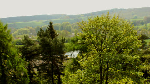 Panning English landscape full of green trees Footage
