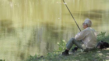 Old Man Fishing. Retired Elderly People, Hobby And stock footage