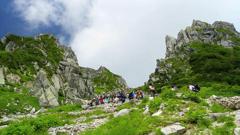 People Trekking At Central Alps In Japan stock footage