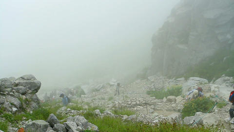 Hikers hiking in the fog Footage