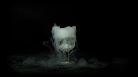 Glass of water with dry ice Footage
