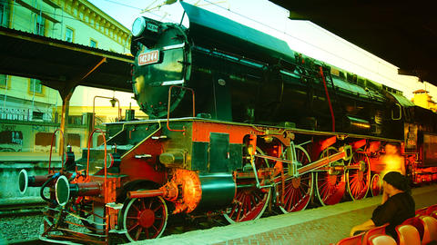 Tourists Looking At Historic Railroad Steam Engine Stock Video Footage