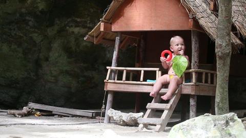 child chews house jungle Footage