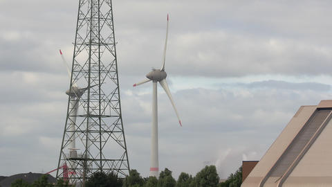 Wind Turbine and Power Pole Stock Video Footage