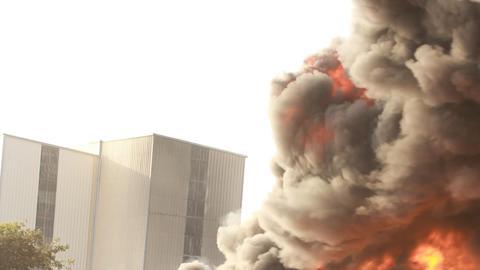 firefighters battle blaze in packaging factory Footage