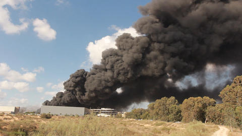 firefighters battle blaze in packaging factory Stock Video Footage