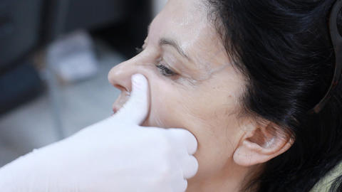Cosmetic treatment in a clinic woman getting a bot Live Action