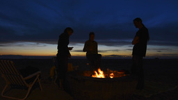 Friends Standing Around A Fire Pit stock footage