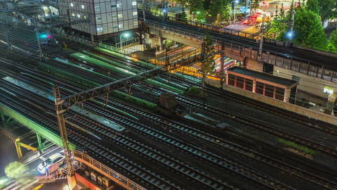 Time lapse of Tokyo trains and traffic at night Footage
