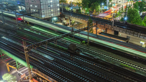 Time lapse of Tokyo trains and traffic at night Stock Video Footage