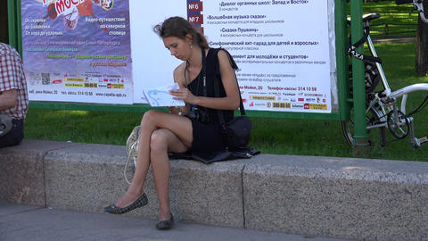 Girl tourist studying a map of the city. 4K Stock Video Footage