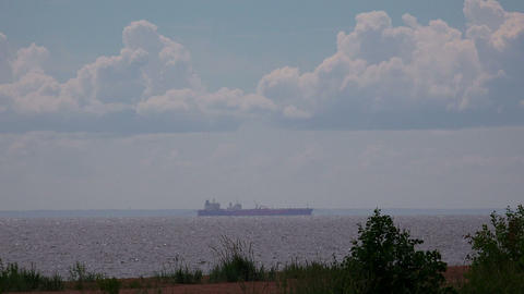 Barge on the horizon. Gulf of Finland. 4K Stock Video Footage