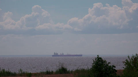 Barge on the horizon. Gulf of Finland. 4K Footage