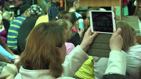 Woman shoots iPad children's holiday. 4K Stock Video Footage