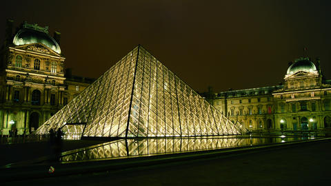 The Louvre and the pyramid in night,time lapse vie Stock Video Footage